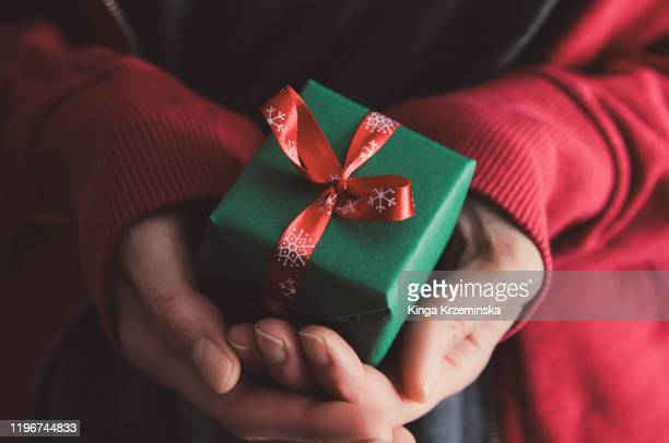 christmas gift - holding stock pictures, royalty-free photos & images