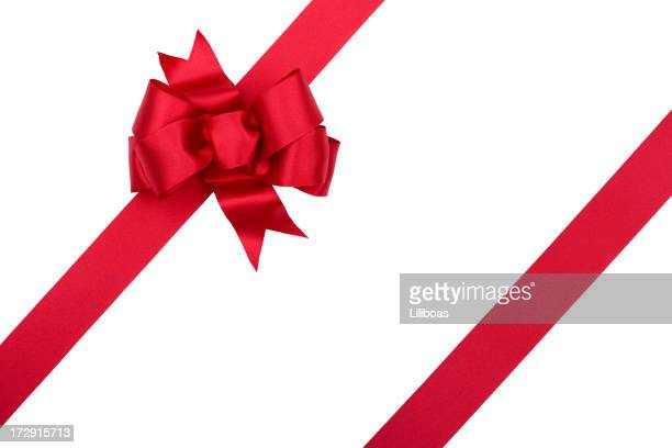 christmas gift red bow isolated on white with clipping path - rood stockfoto's en -beelden