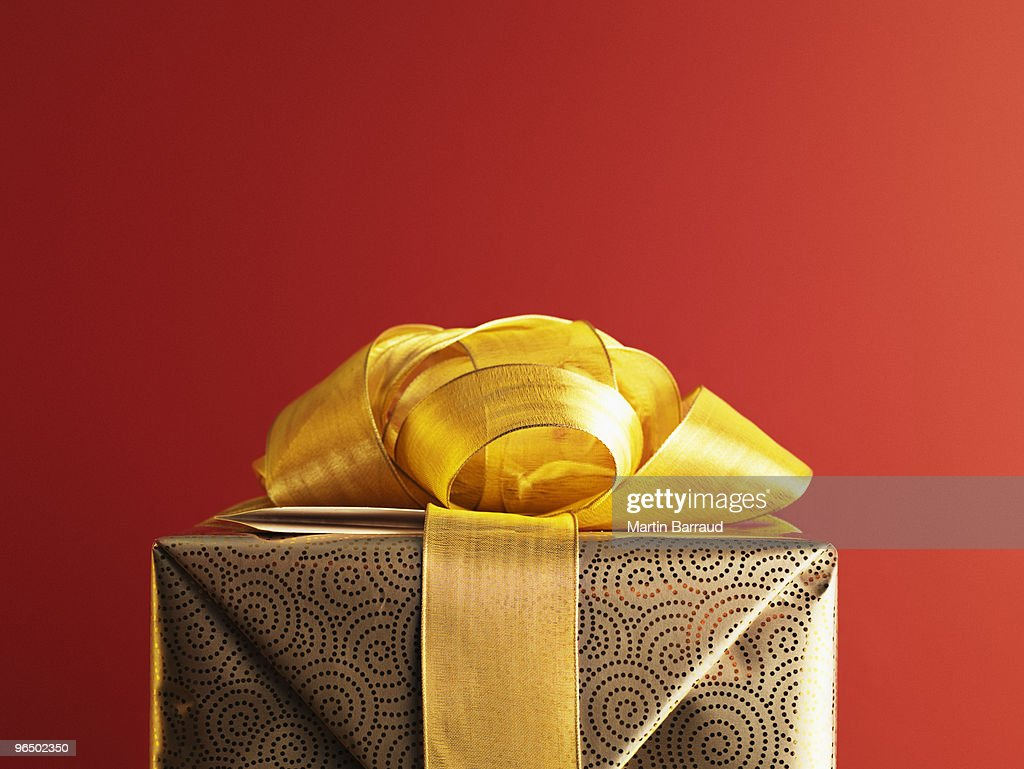 Christmas gift with gold ribbon stock photo getty images christmas gift with gold ribbon stock photo negle Gallery