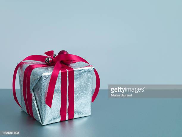 Christmas gift with red ribbon and silver wrapping