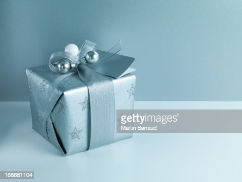 Christmas gift with silver ribbon and wrapping stock photo getty similar images negle Images