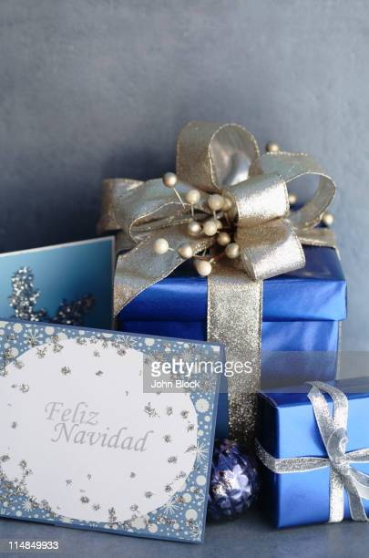 christmas gifts and christmas card - feliz navidad stock photos and pictures