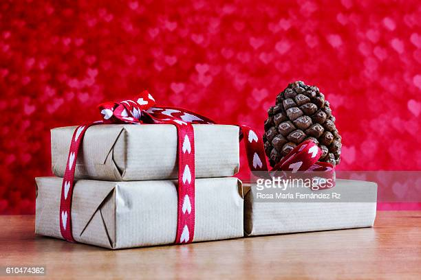 Christmas gifts boxes with a pinecone on abstract background.