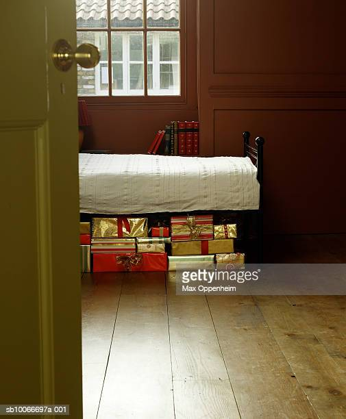 Christmas gifts hidden underneath bed