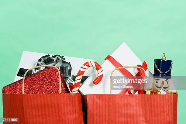 christmas gifts in a shopping bag - army soldier toy stock pictures, royalty-free photos & images
