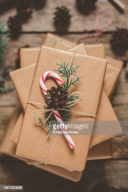 christmas gifts on wooden table - macedonia country stock pictures, royalty-free photos & images