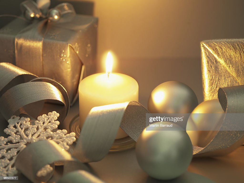 Christmas gifts, ornaments and candle : Stock Photo