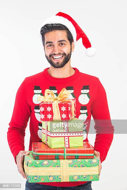 christmas gifts - ugly christmas sweater stock photos and pictures