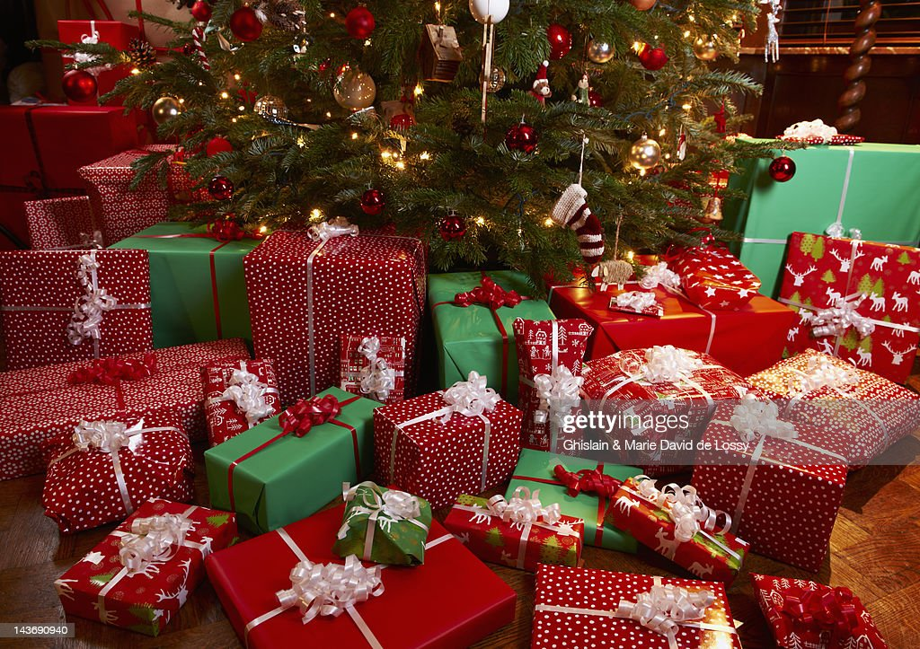 Christmas Gifts Under Tree High-Res Stock Photo - Getty Images