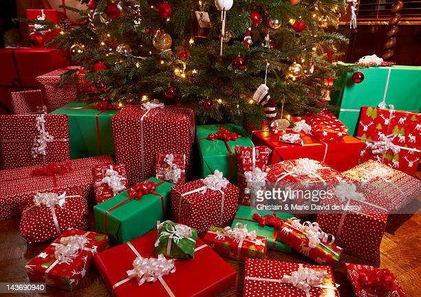 christmas gifts under tree - large group of objects stock pictures, royalty-free photos & images