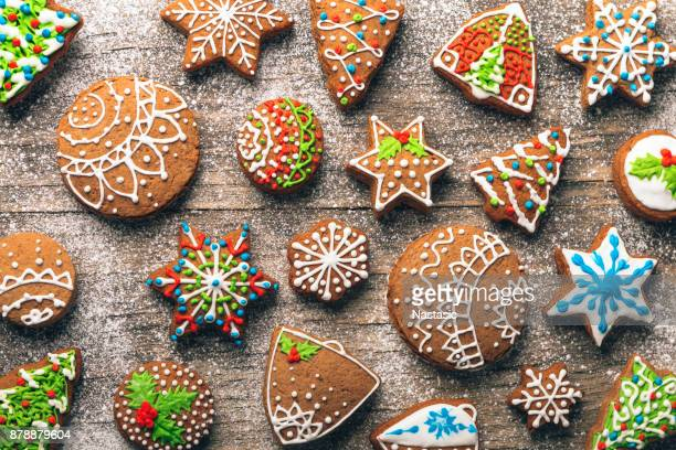 christmas gingerbread cookies on wooden table - holiday stock pictures, royalty-free photos & images