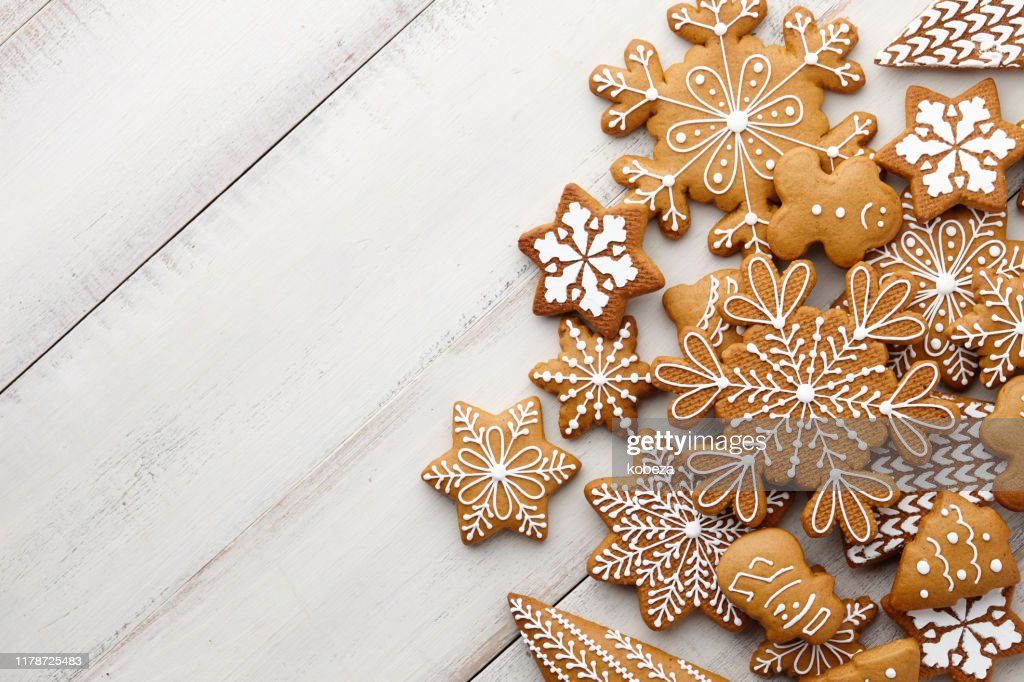 Christmas gingerbread cookies set on white planks : Stock Photo