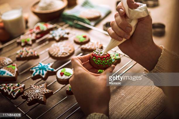 christmas gingerbread cookies with tasty colorful sugar - decorating stock pictures, royalty-free photos & images