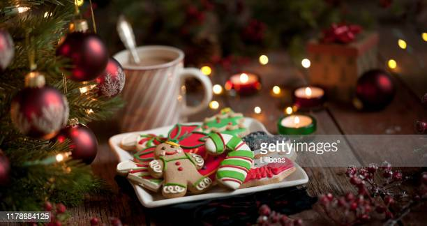 christmas gingerbread man, cookies and hot chocolate on an old wood background - christmas decore candle stock pictures, royalty-free photos & images