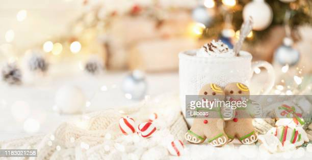 christmas gingerbread man cookies and hot chocolate - fun background stock pictures, royalty-free photos & images