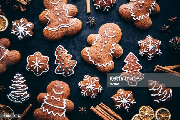 christmas gingerbread man cookies and spices - public celebratory event stock pictures, royalty-free photos & images