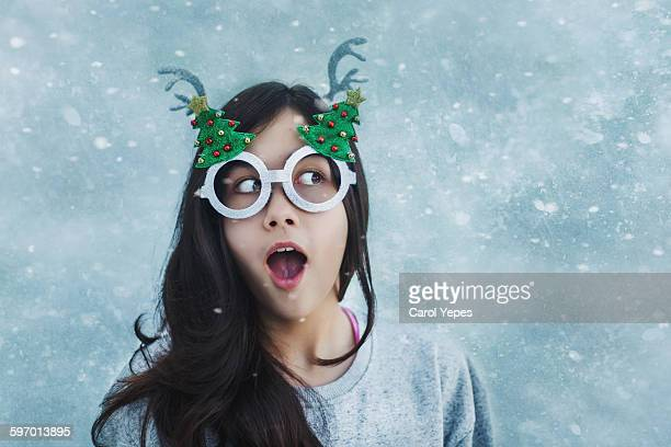 christmas girl - thick rimmed spectacles stock photos and pictures