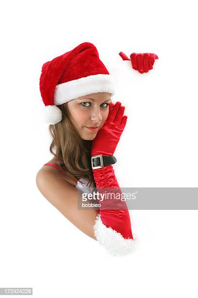 weihnachten mädchen mit schild - weihnachtsfrau stock-fotos und bilder