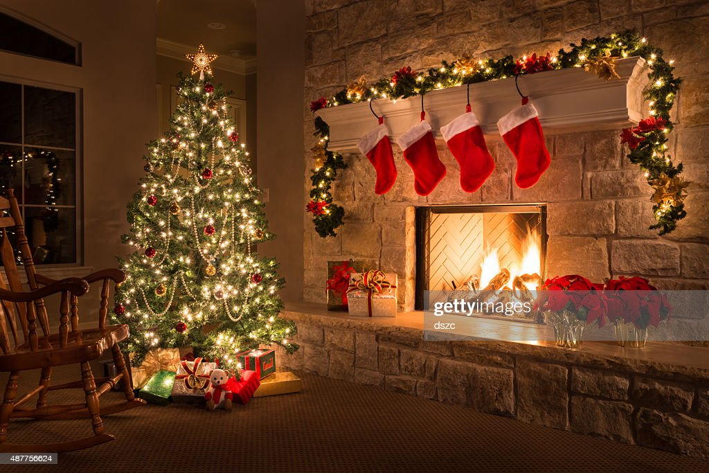 Christmas. Glowing fireplace, hearth, tree. Red stockings. Gifts and decorations. : Stock Photo