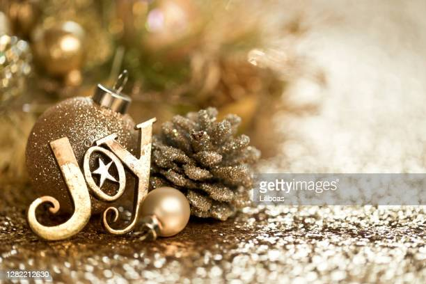 christmas gold ornaments background - national holiday stock pictures, royalty-free photos & images