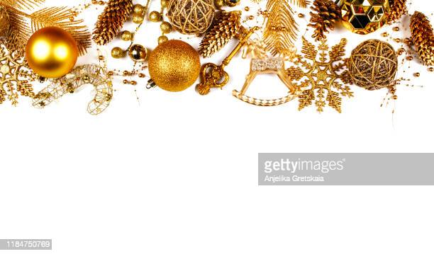 christmas golden ornaments on white background. christmas decoration. christmas card. - christmas frame stock pictures, royalty-free photos & images