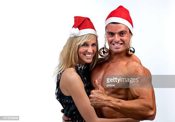 salutations de noël du musclé homme et d'une femme blonde - blonde forte poitrine photos et images de collection
