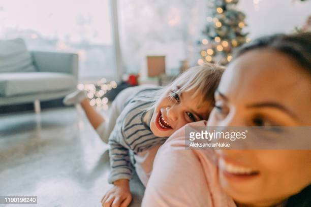 christmas happiness - 2 5 months stock pictures, royalty-free photos & images