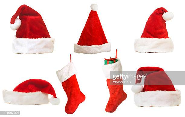 christmas hats and stockings - christmas stocking stock photos and pictures
