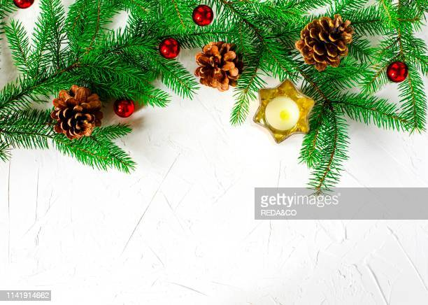 Christmas holiday background with fir branches pine cones and ornaments Winter holiday concept composition copy space