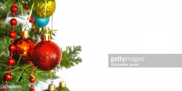 christmas holiday background with hanging decorative ornaments - christmas banner stock photos and pictures