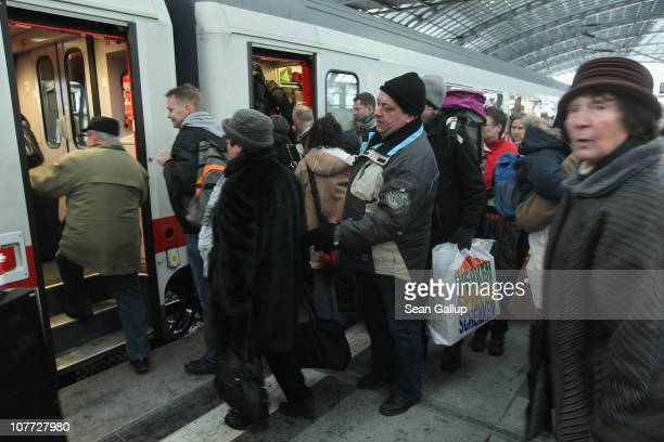 Christmas holiday travellers board a train on a crowded platform at Hauptbahnhof railway station on December 22 2010 in Berlin Germany German state...