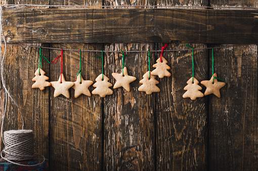 Christmas homemade gingerbread cookies on rustic  wooden background with copy-space - gettyimageskorea