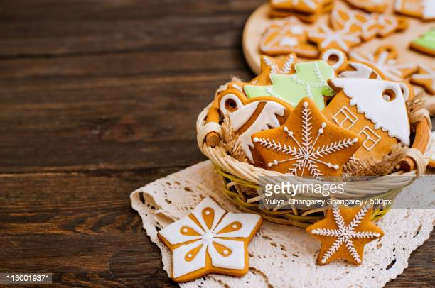 christmas homemade gingerbread on a wooden background - inexpensive stock photos and pictures