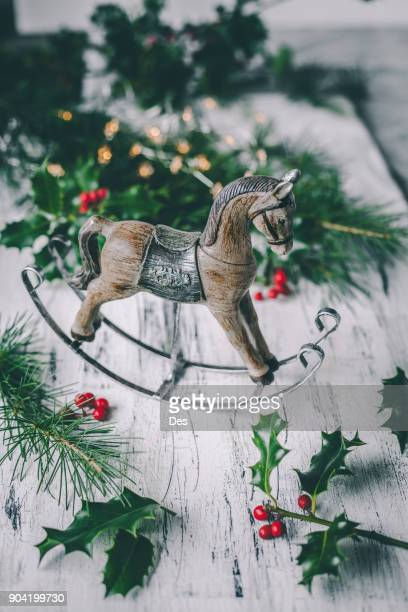 christmas horse decoration with pine, holly and berries - christmas horse stock pictures, royalty-free photos & images