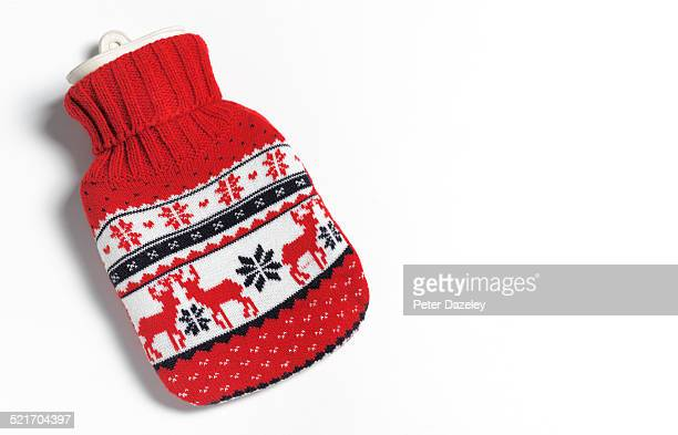 christmas hot water bottle - knitting stock pictures, royalty-free photos & images