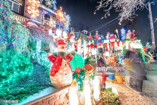 christmas house decoration lights display in the suburban brooklyn neighborhood of dyker heights - dyker heights stock pictures, royalty-free photos & images