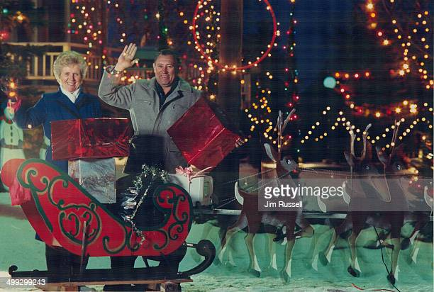 Christmas house of lights Jack and Muriel Scott recently flipped the switch to light up Santa and his sleigh eight reindeer three carollers a...