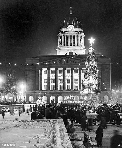 Christmas illuminations in the Market Square Nottingham Nottinghamshire c1950s The Christmas tree illuminated by the Lord Mayor with the Council...