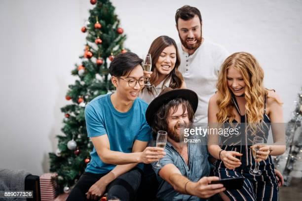Christmas in Australia and friends taking selfie for social media