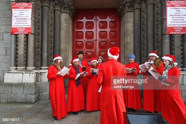 christmas in dublin: carolers singing at st ann's church - salvation army stock photos and pictures