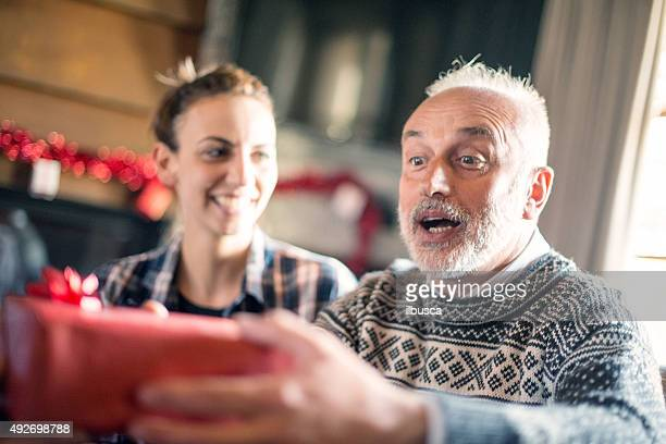 christmas in mountain house: family giving presents - hot women making out stock pictures, royalty-free photos & images