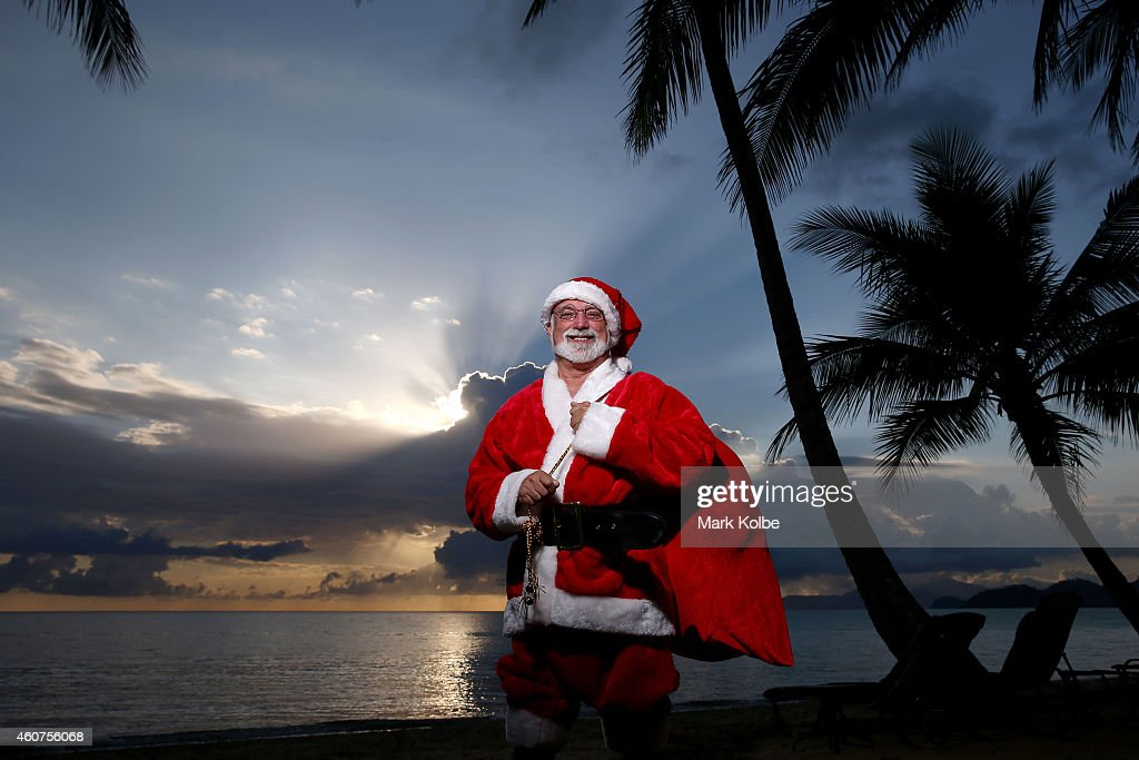 Christmas in paradise.Santa chills out at one of Queensland, Australias tropical beaches before the big night. Queensland's beaches rank amongst the best in the world and Christmas in Queensland is about sun and summer. You'll find the warmest, whitest, biggest and most beautiful beaches stretched along the 7,400km coastline of Queensland, Australia.