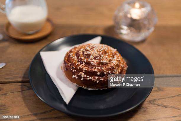 christmas in sweden - cinnamon bun (kanelbulle) - swedish culture stock pictures, royalty-free photos & images