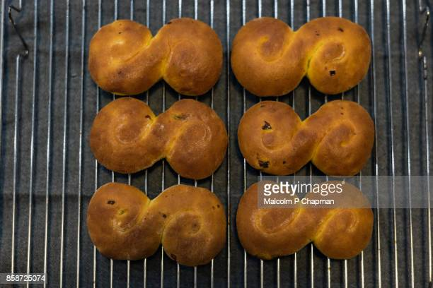 christmas in sweden - lussekatter - swedish saffron buns - swedish culture stock pictures, royalty-free photos & images