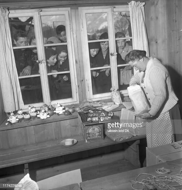 Christmas in the destroyed village BlauseeMitholz 1947 Woman with parcels