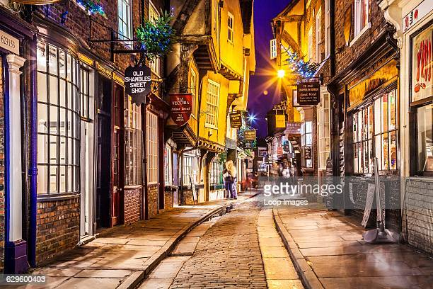 Christmas in The Shambles which is the medieval street in the old city centre of York at twilight York England