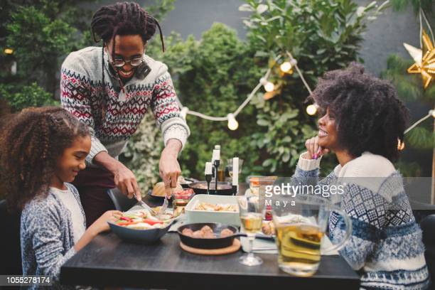 christmas is almost here - black family dinner stock photos and pictures