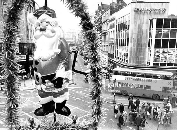 Christmas is Coming Liverpool's city lighting engineers start putting up decorations Church Street Liverpool 29th October 1976