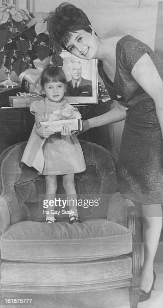 DEC 20 1967 DEC 24 1967 Christmas is for children and Kimbrough Burg 2 shows her mother Mrs Charles Burg one of the presents she found when they...