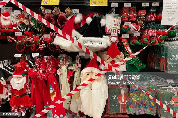 Christmas items with tape across them in a Cardiff Bay Home Bargains store on October 27 in Cardiff, Wales. Pressure has mounted on the Welsh...